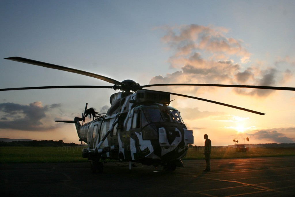 "Sea King ""R"" ZF115 at sunset just before take off"