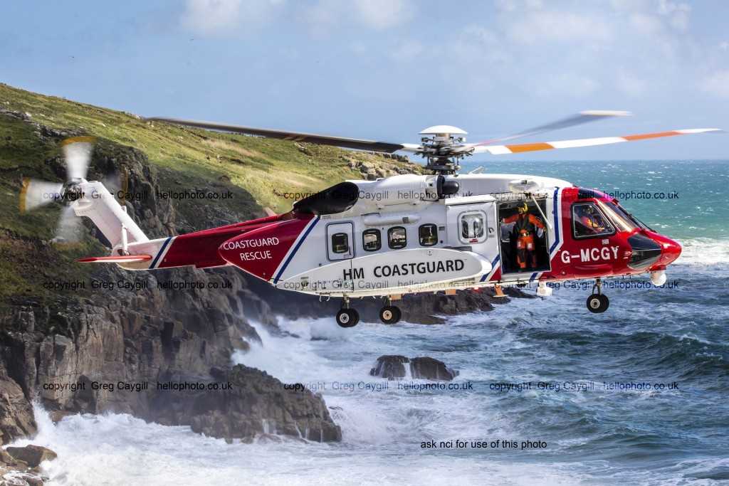 Newquay's NCI Coastguard Helicopter with Cornish cliffs, 2017